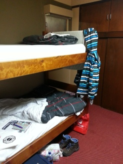 Pinewood Lodge's 4-bed dorm, featuring my dazzling coat.